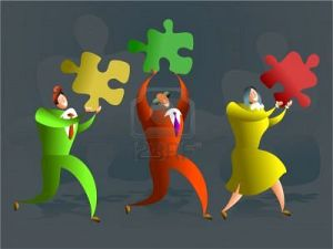 574573-team-of-executives-carrying-puzzle-pieces--conceptual-illustration