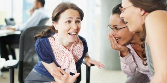 Businesswomen gossiping in office