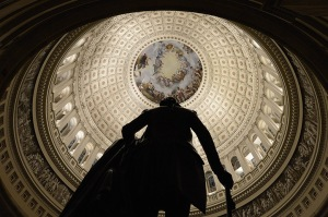The Capitol Rotunda behind the silhouette of a sculpture of the first US Pr