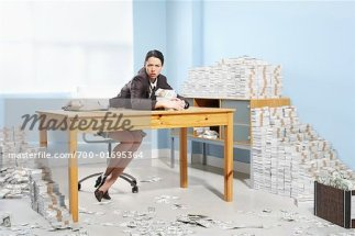 700-01695364 © Jerzyworks Model Release: Yes Property Release: Yes Model & Property Release Businesswoman Surrounded by Money