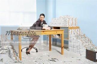 700-01695364 © Jerzyworks Model Release: Yes Property Release: Yes Model & Property Release Businesswoman Surrounded by Money