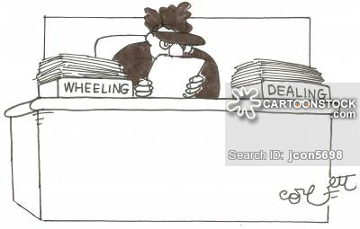 Man with desk organizers labelled 'Wheeling' and 'Dealing'.