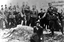 UNSPECIFIED - CIRCA 1754: The Final Solution to the Jewish Question: An Einsatzgruppe D soldier about to shoot a Jew kneeling at a partially filled mass grave in Vinnitsa, Ukrainian SSR, Soviet Union, in 1942. The Einsatzgruppen were SS paramilitary task forces whose main purpose was the extermination of Jews. (Photo by Universal History Archive/Getty Images)