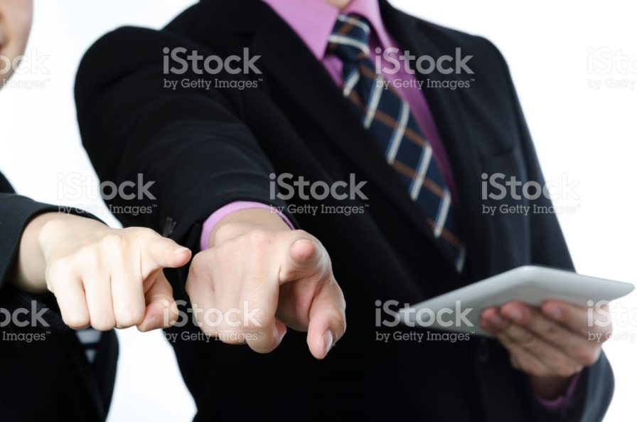 Business man and woman are pointing fingers at you, isolated on white background. Close up.