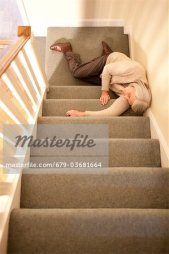 679-03681664 © Masterfile Royalty-Free Model Release: Yes Property Release: No Senior woman injured in fall down the stairs.